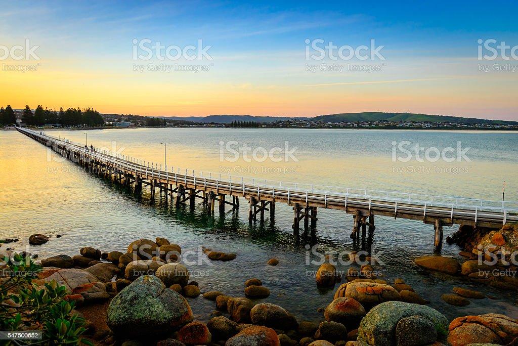 Victor Harbor foot bridge at sunset stock photo