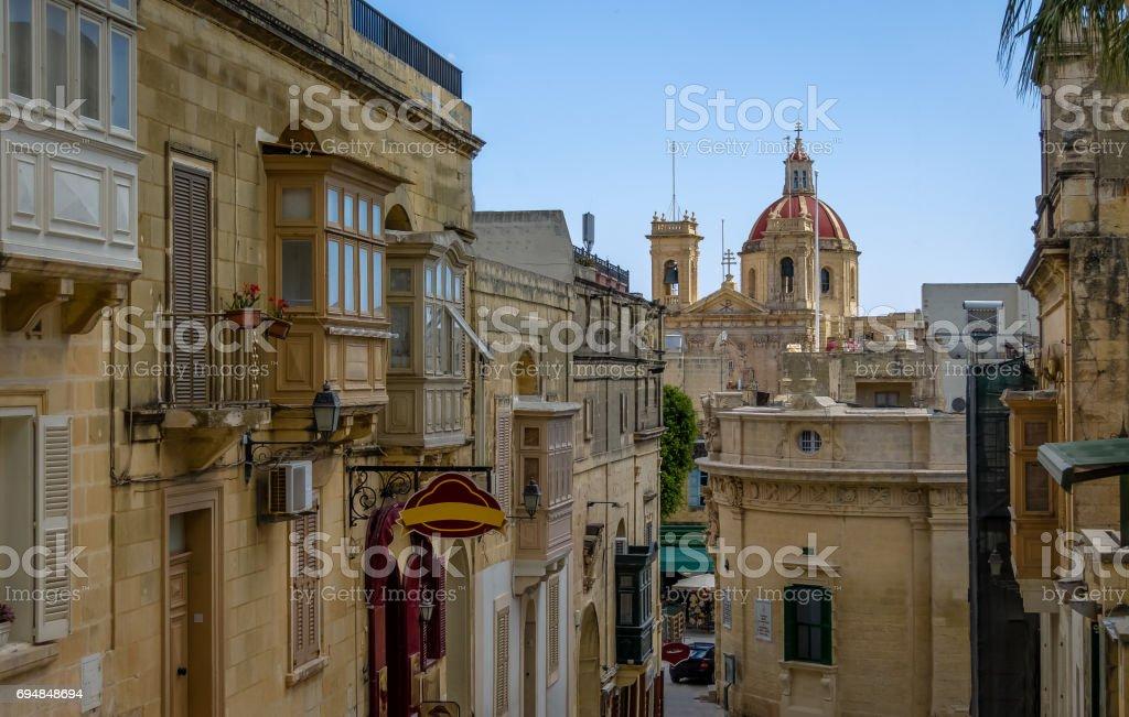 Victoria city street with Saint George Basilica red dome - Victoria, Gozo, Malta stock photo