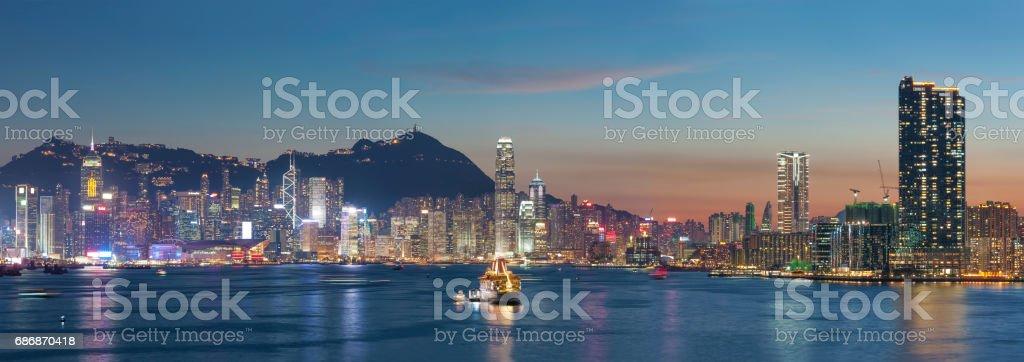 Victoria Harbor of Hong Kong city at dusk stock photo