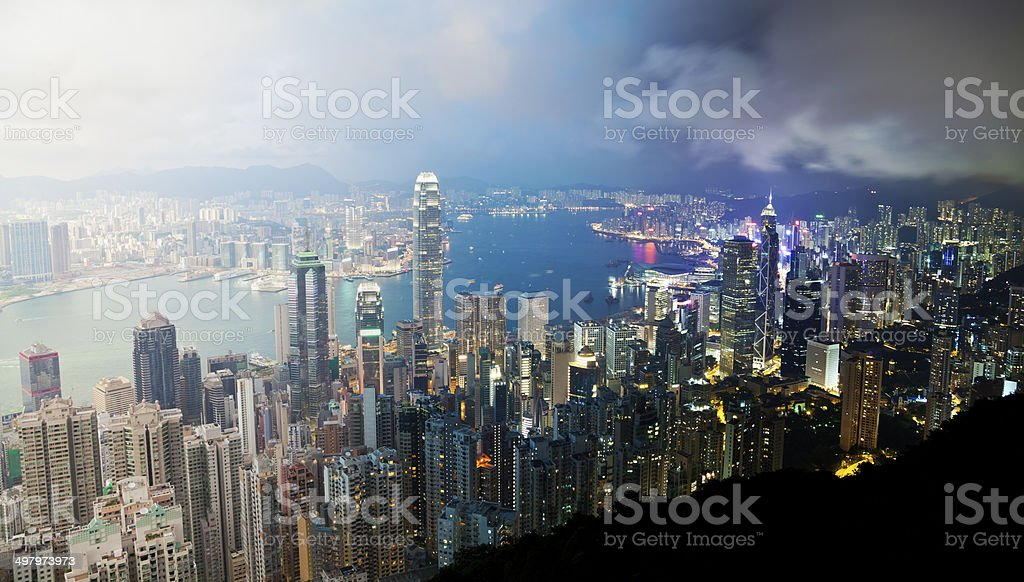 Victoria Harbour in Hong Kong from day to night stock photo