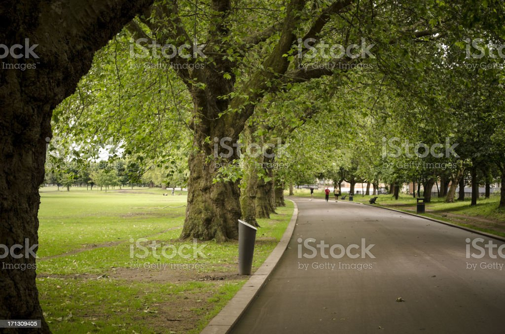 Victoria Park and distant joggers east london stock photo