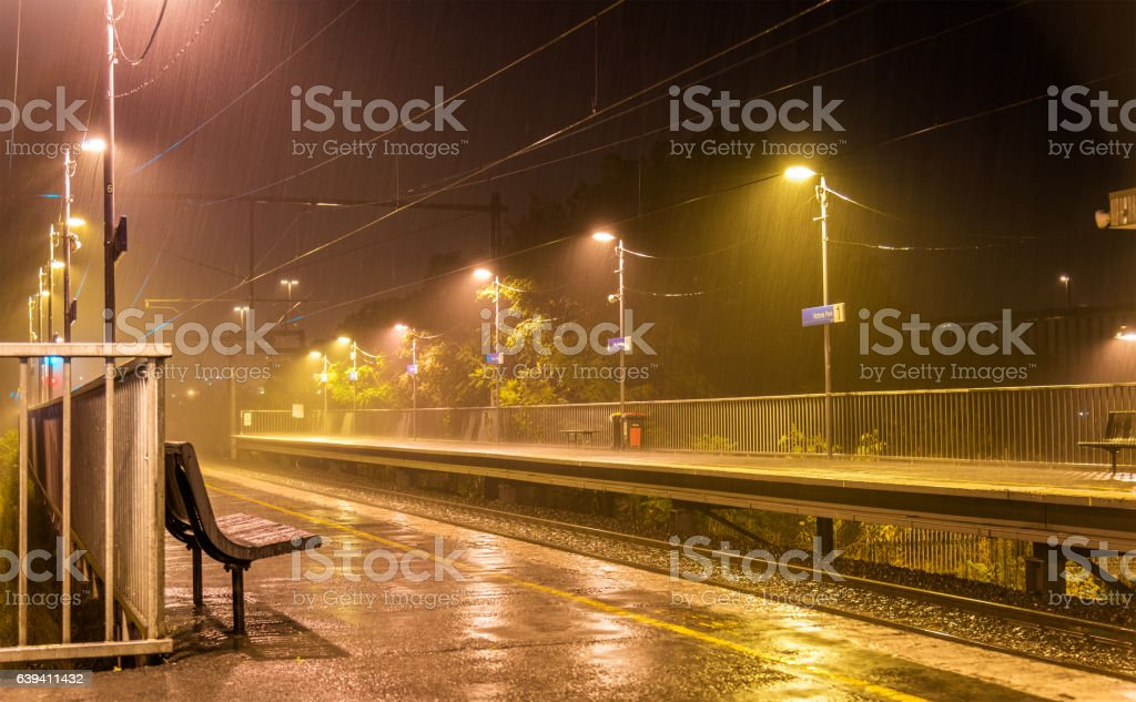 Victoria Park station in the rain at night - Melbourne stock photo