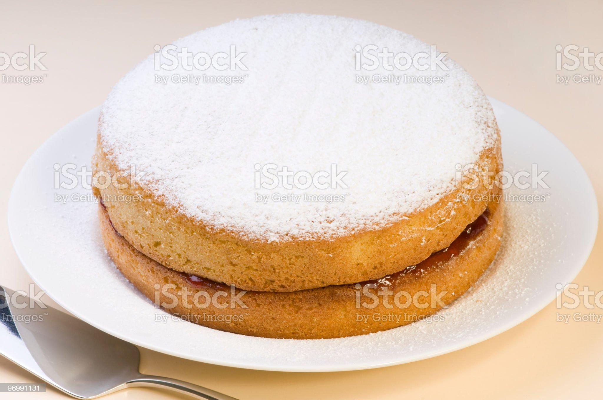 Victoria sponge cake with powdered sugar royalty-free stock photo