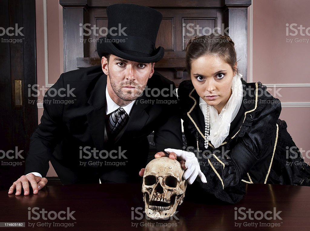 Victorian Couple with a Skull royalty-free stock photo