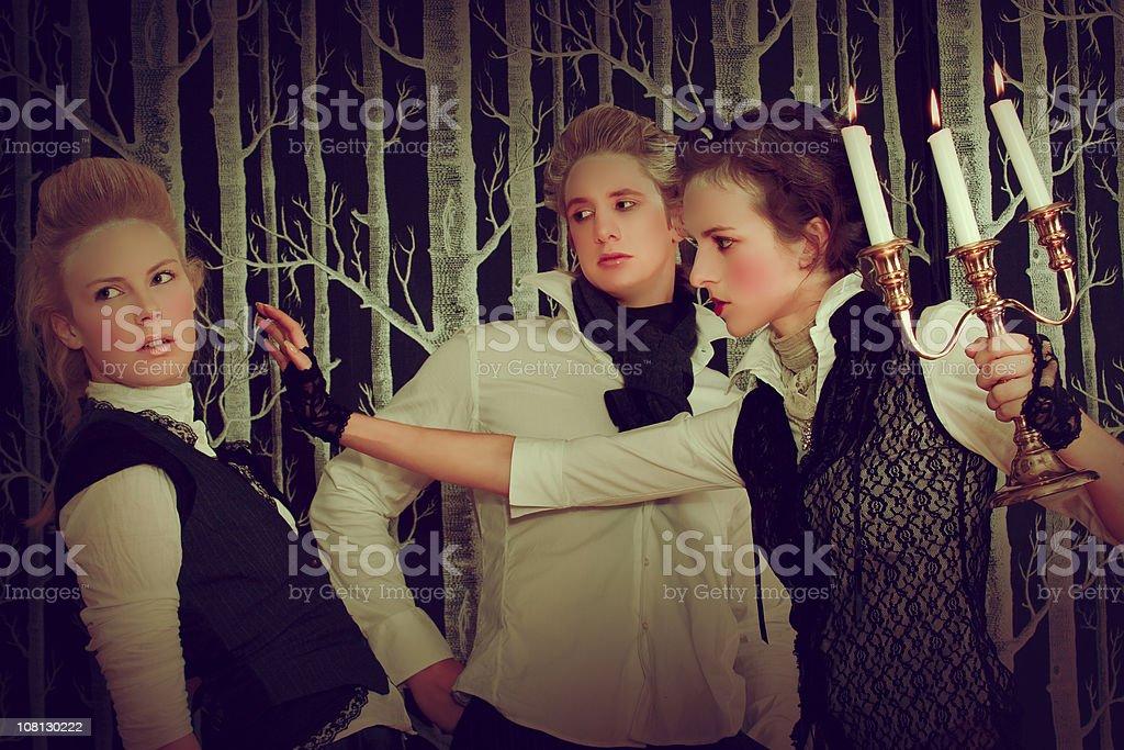 Victorian Era Women Fighting Over man royalty-free stock photo