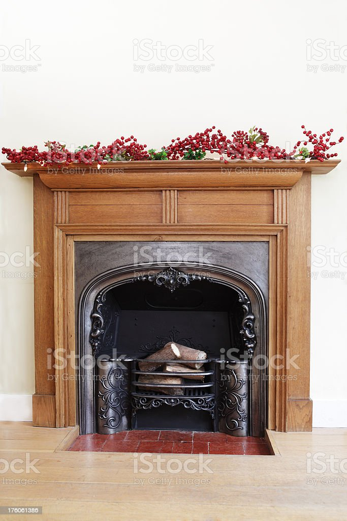 Victorian Fireplace with Christmas Decorations stock photo