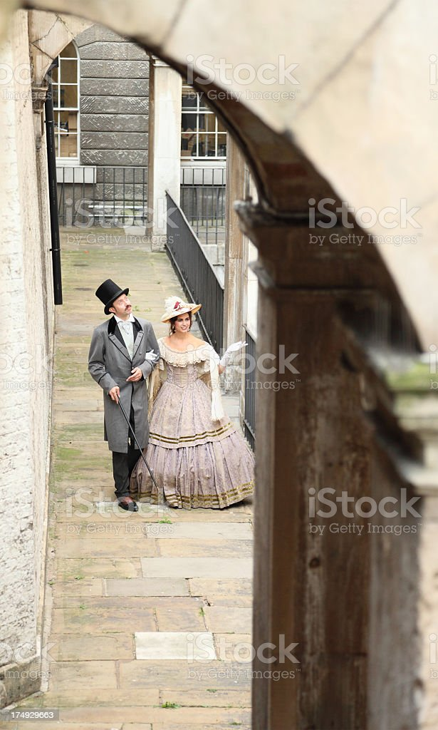victorian gentleman and lady stroll in London passageway stock photo