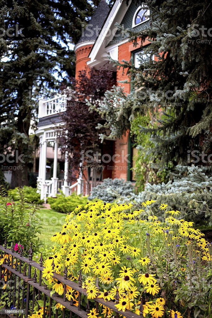 Victorian House with Flower Garden royalty-free stock photo