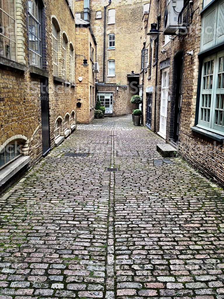 Victorian London with bricked road royalty-free stock photo