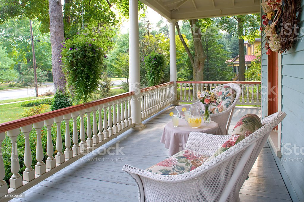 Victorian porch with vintage armchairs in summertime stock photo