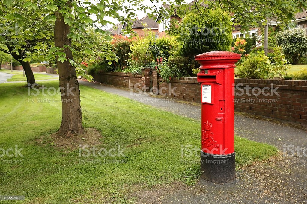 Victorian red post box in Wilmslow, United Kingdom stock photo