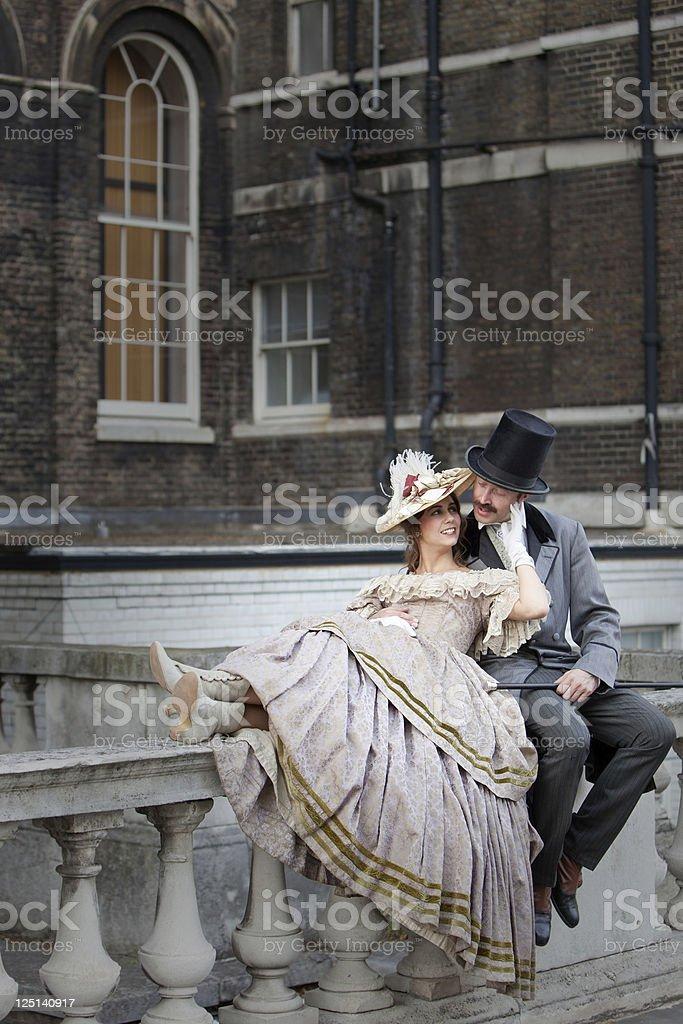 Victorian romantic couple on balustrade royalty-free stock photo
