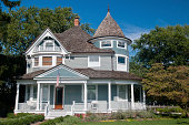 A Victorian style home with wrap-around porch