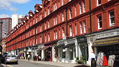 Victorian style red brick terraced row of shops, Chiltern Street