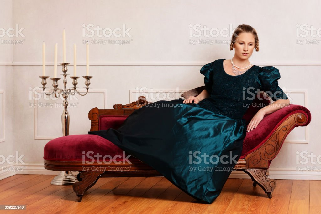 victorian woman on fainting couch stock photo