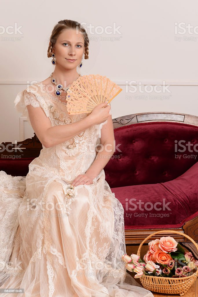 Victorian Woman With Fan On Fainting Couch Royalty-free Stock Photo