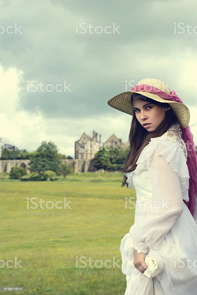 victorian woman with manor house stock photo