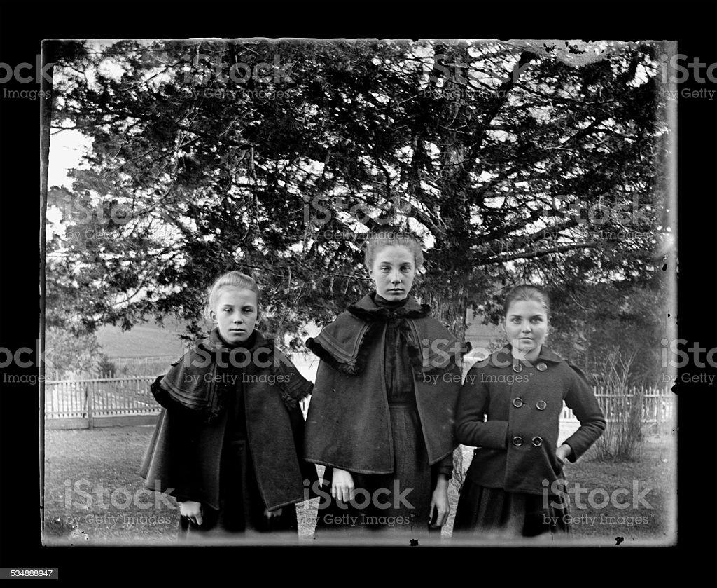 Victorian-era Girls Wearing Winter Cloaks stock photo