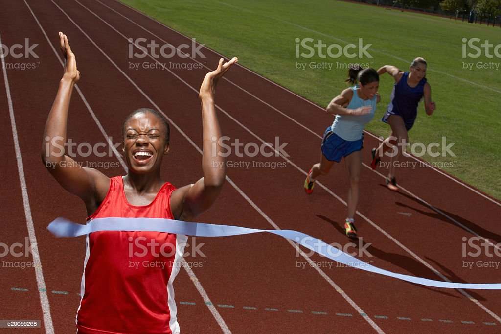 Victorious runner stock photo
