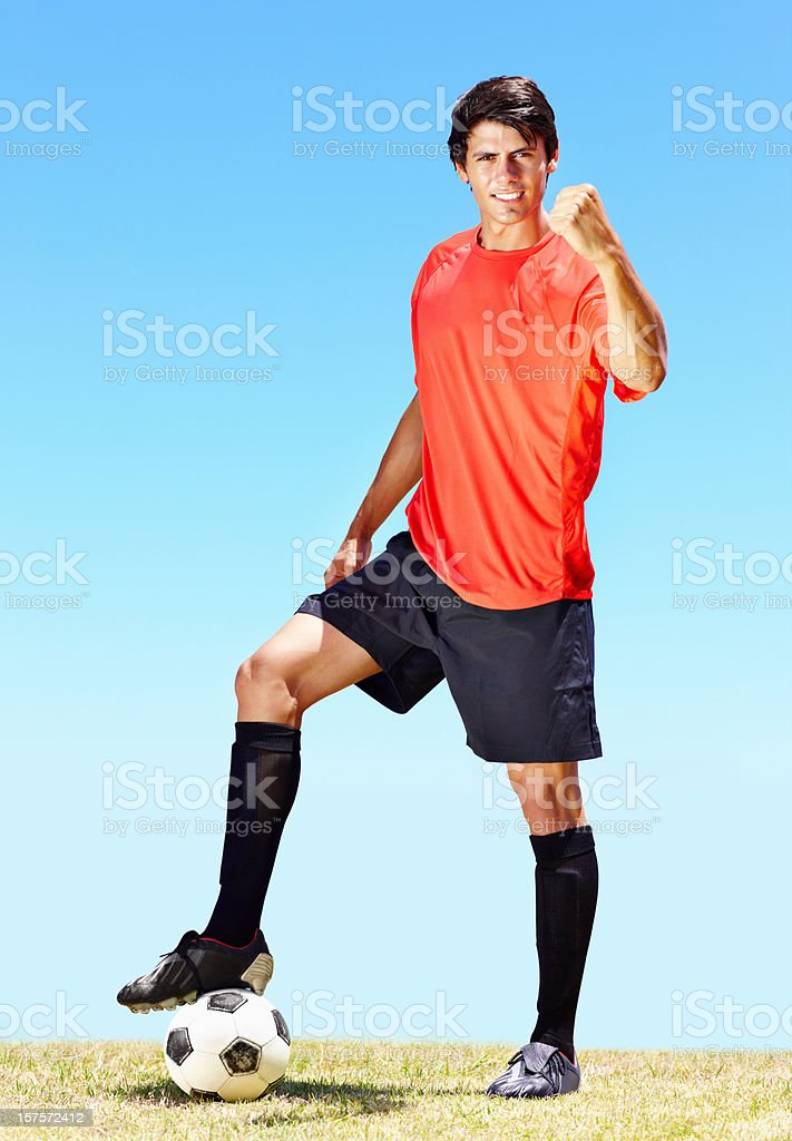 Victorious young football player at the field royalty-free stock photo
