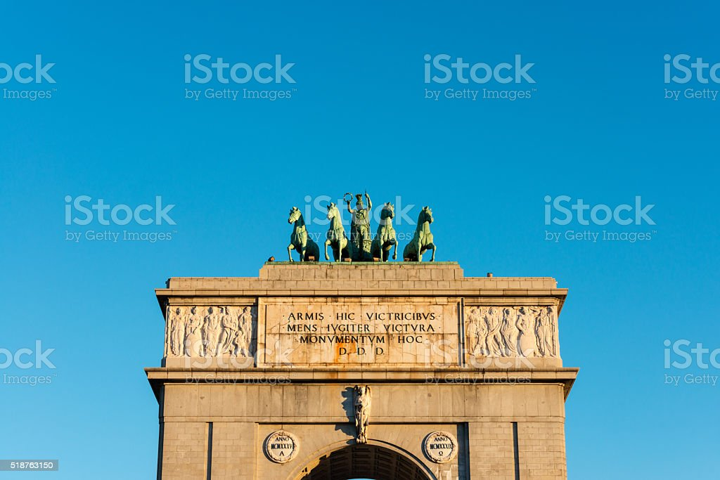 Victory Arch against a blue sky in Madrid stock photo