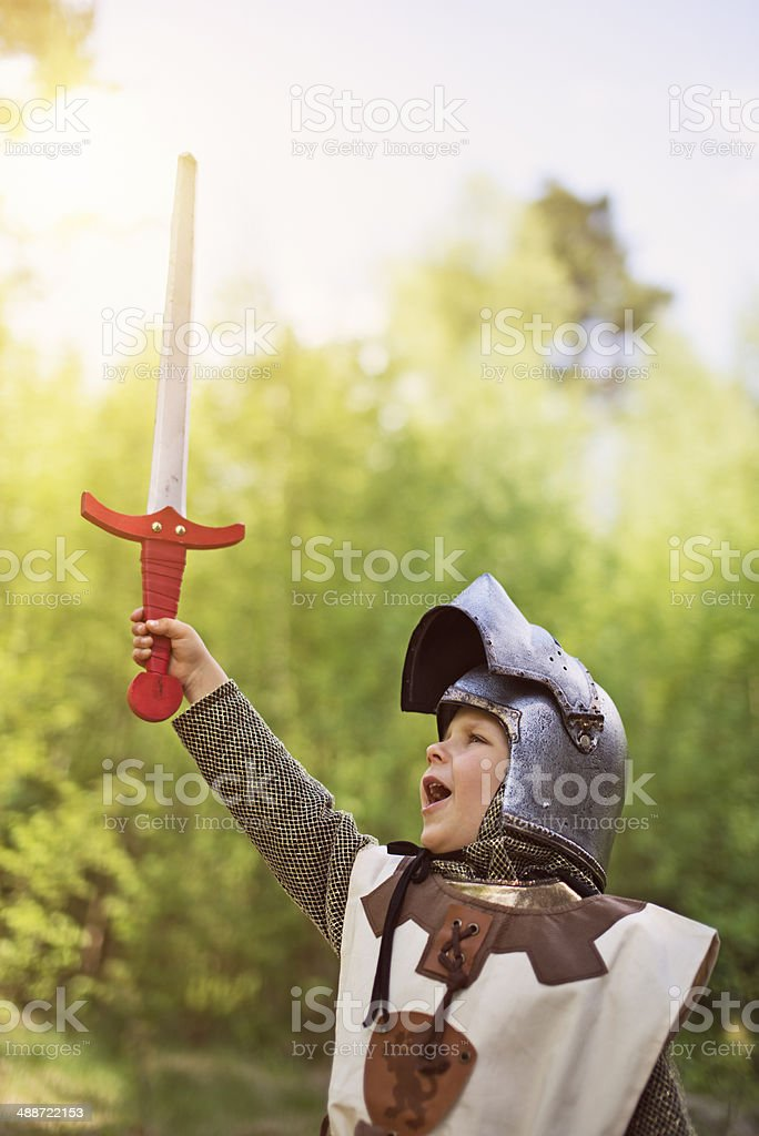 Victory for the little knight stock photo