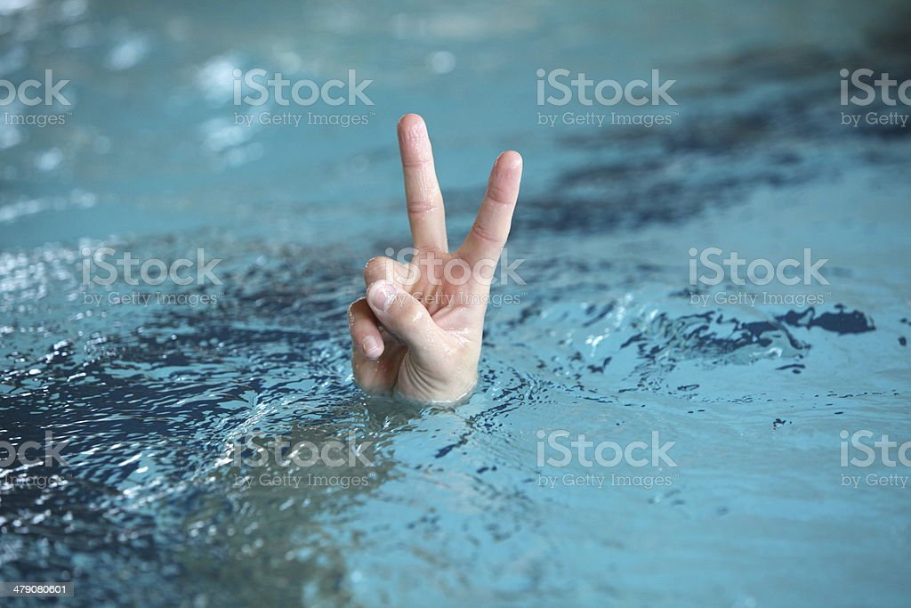 victory or peace symbol,above water surface - body language royalty-free stock photo