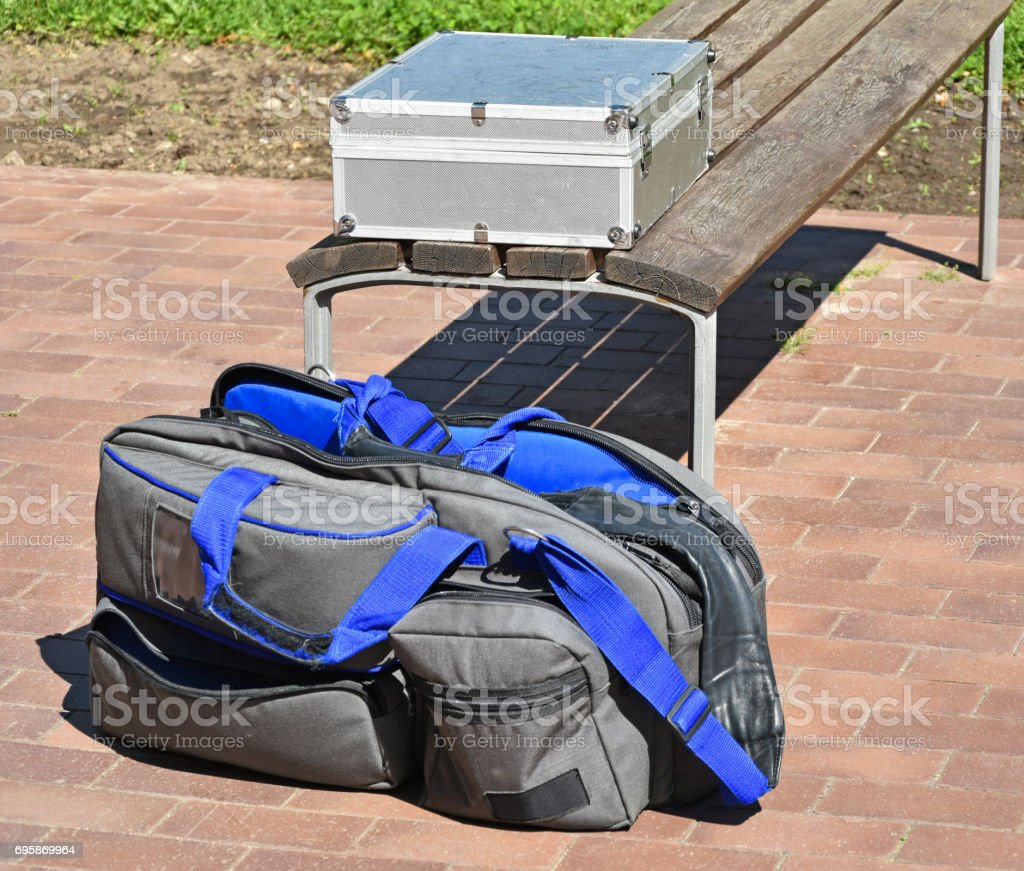 Video camera bag next to a bench stock photo