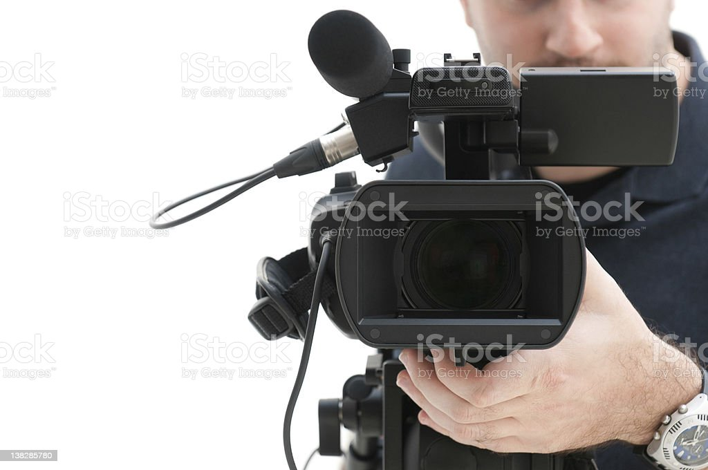 Video camera operator pointing camera at viewer stock photo