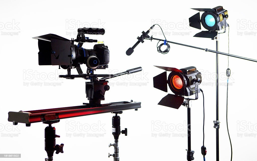 DSLR video camera with slider and studio gear on white royalty-free stock photo