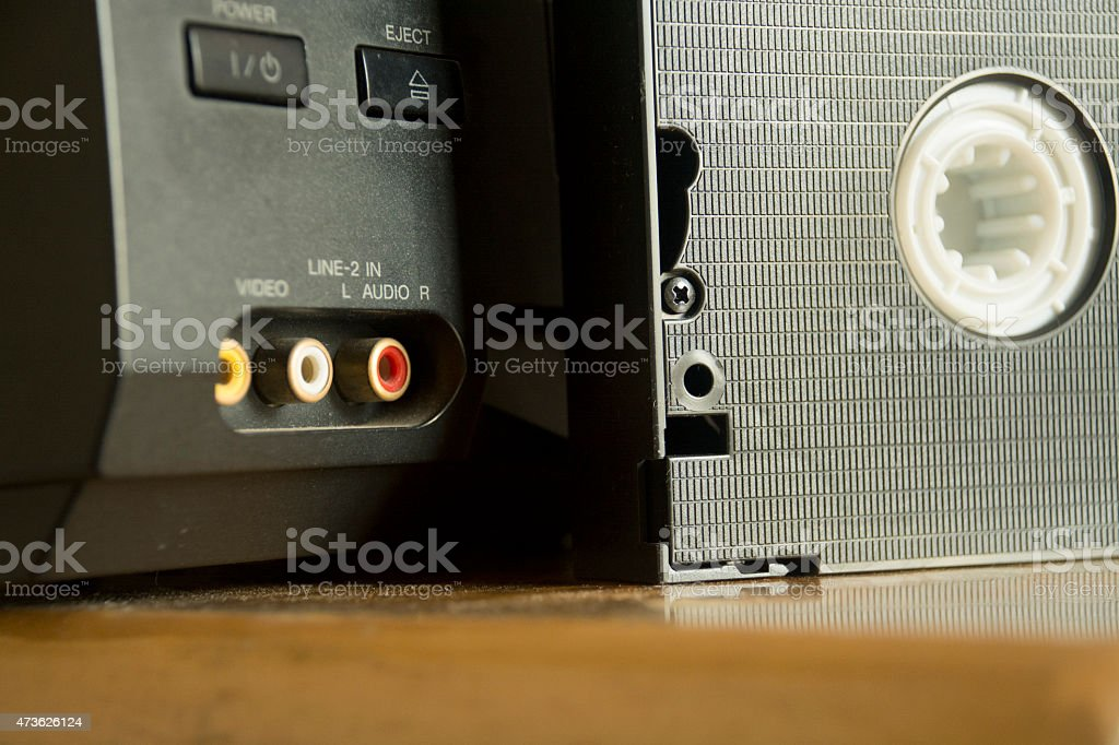 Video cassette with a VCR stock photo