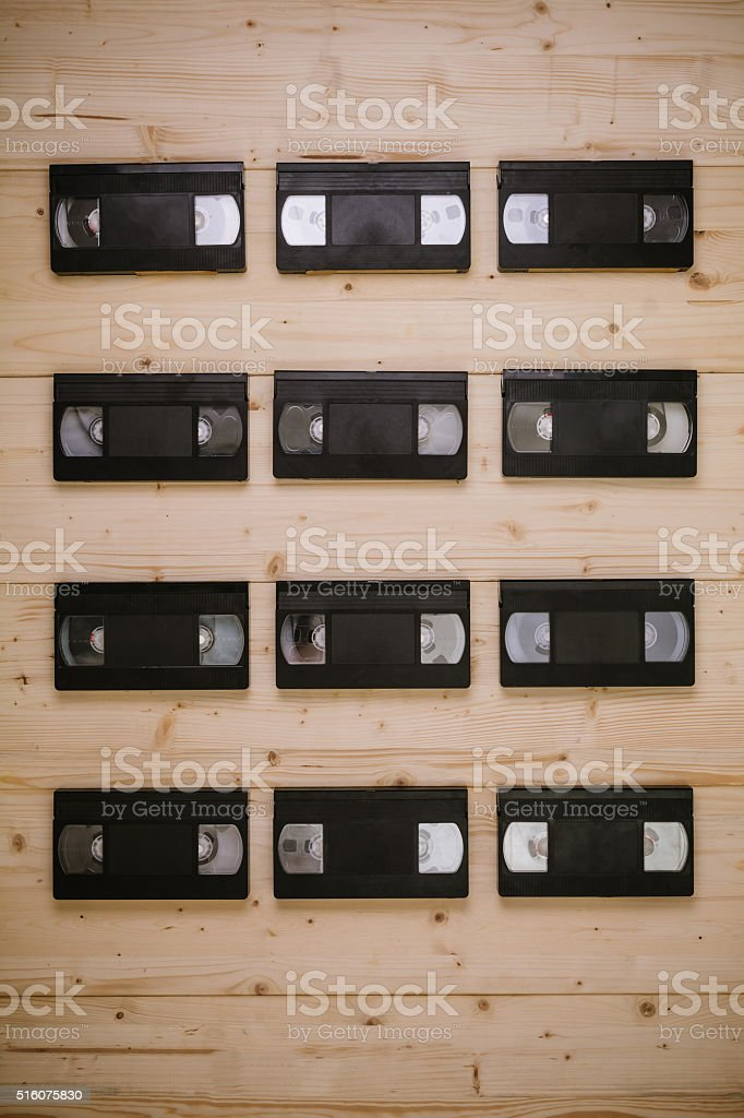 Video cassettes on a wooden background stock photo