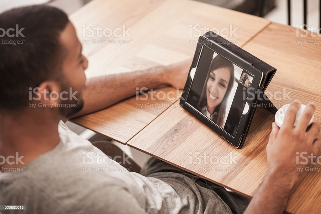 Video chat in a coffee shop stock photo
