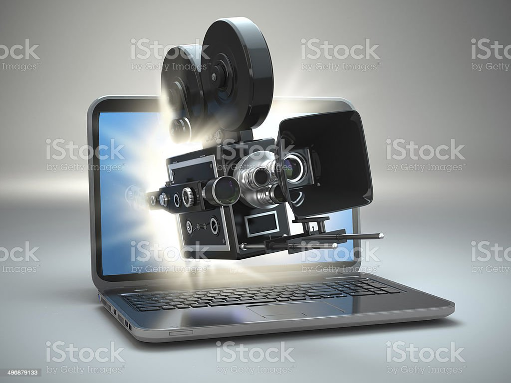 Video concept. Retro camera and  laptop. stock photo