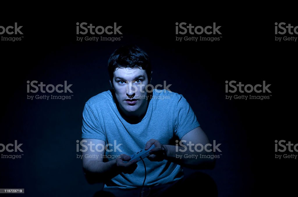 Video Game Addiction, Teenager with Hand Held Controller stock photo