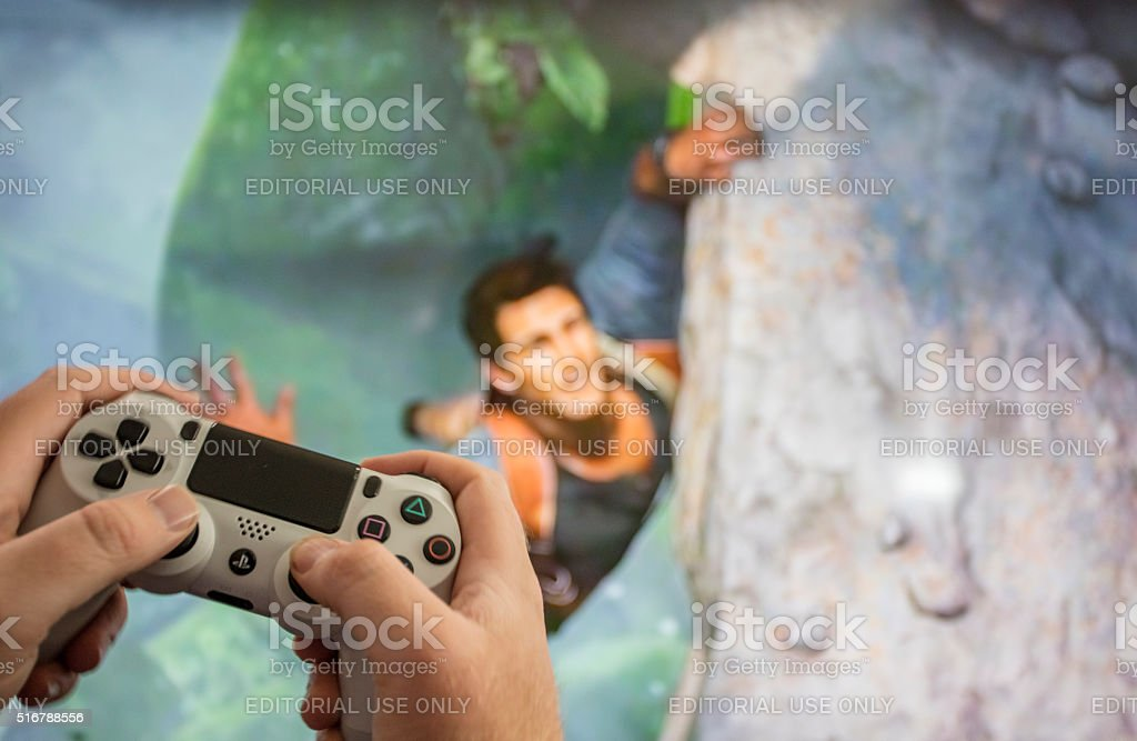 PS4 video game Uncharted 4 stock photo