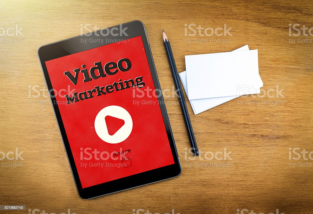 Video Marketing on mobile device screen with pen stock photo