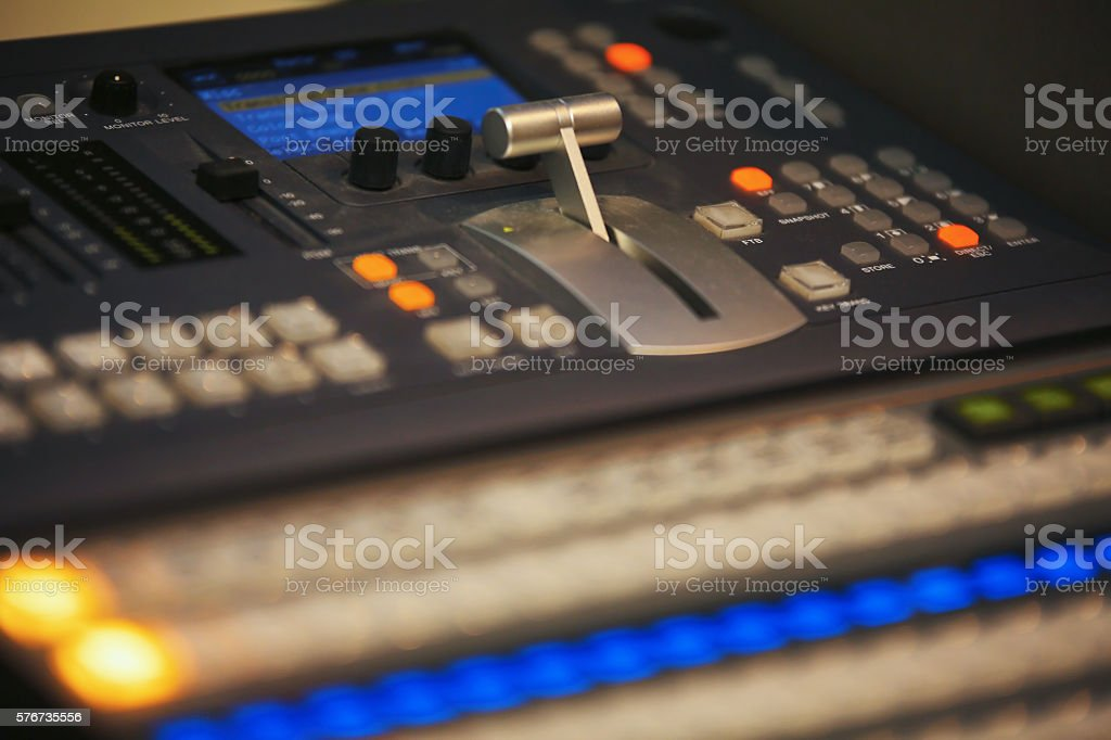 Video mixing control table at tv studio stock photo