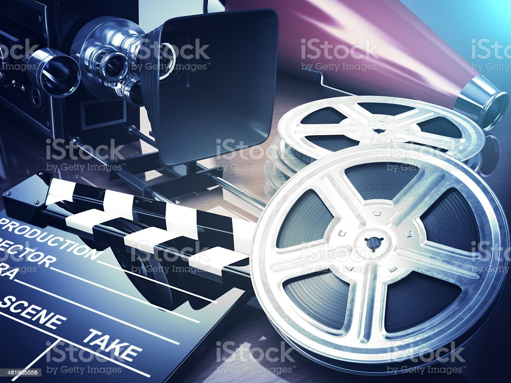 Video, movie, cinema vintage concept. Retro camera, reels and cl stock photo