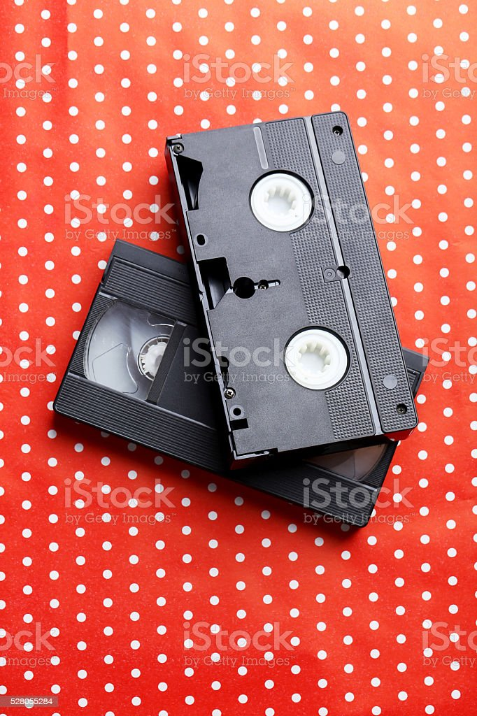 Videocassette on the red background stock photo