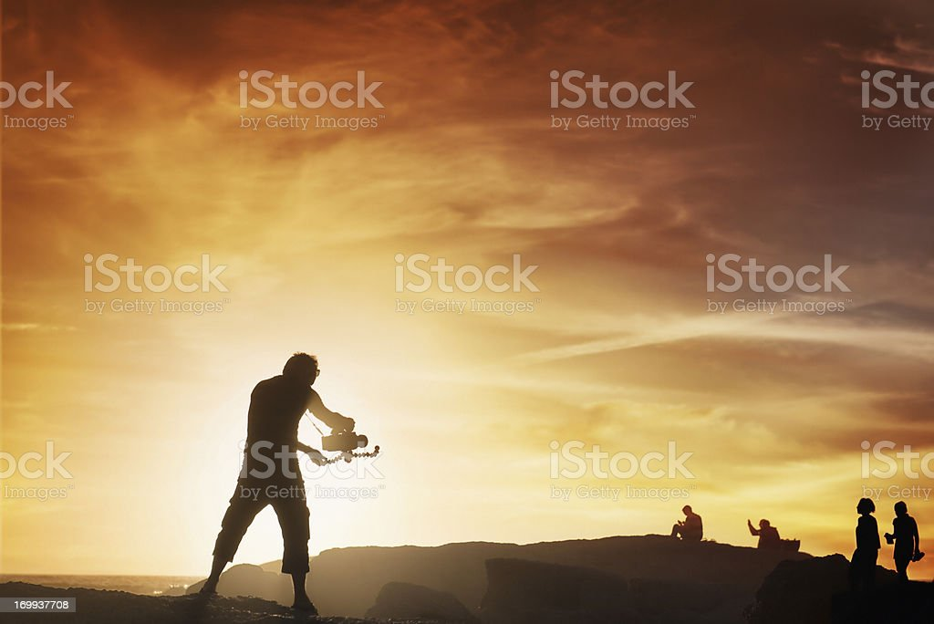 Videographer at Sunset royalty-free stock photo