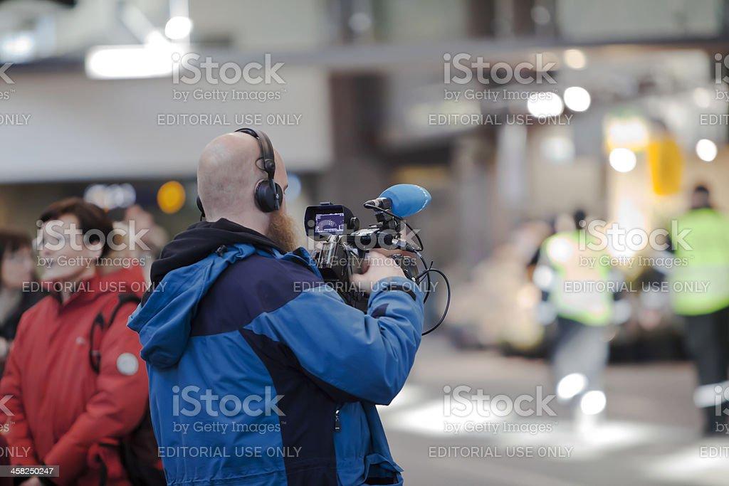 Videographer checking his camera. stock photo