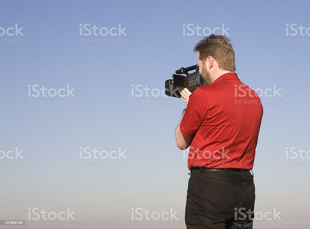 Videographer shooting footage royalty-free stock photo