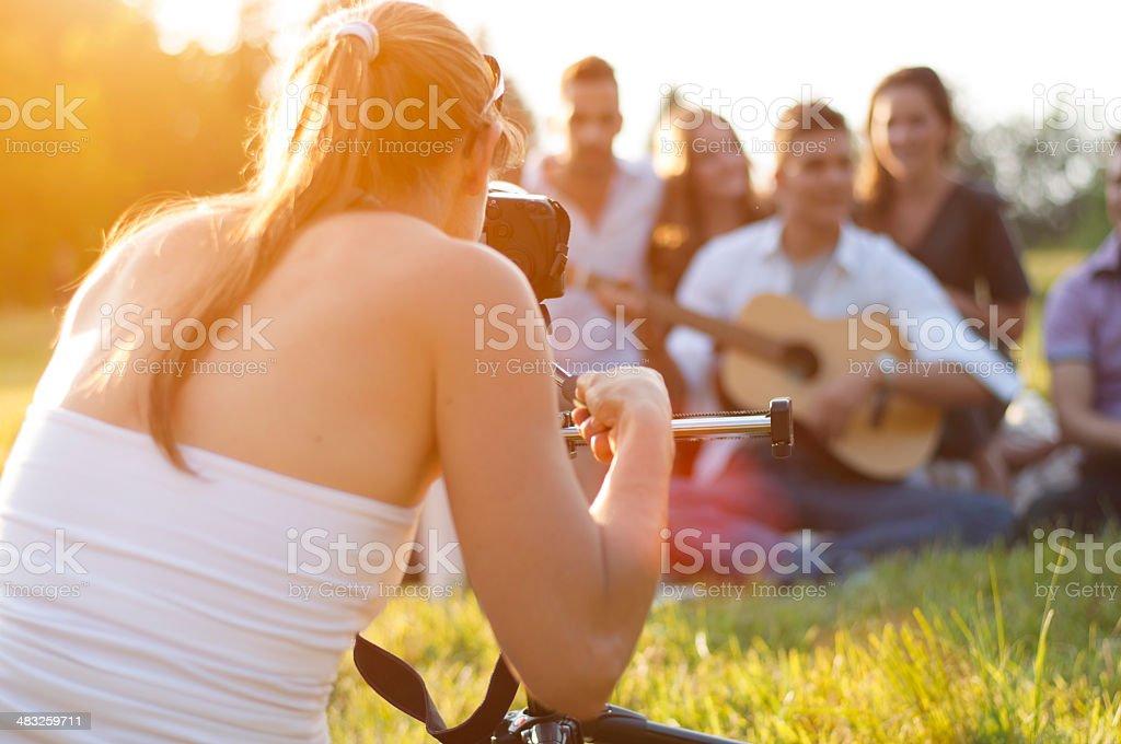 Videographer shooting teenagers stock photo