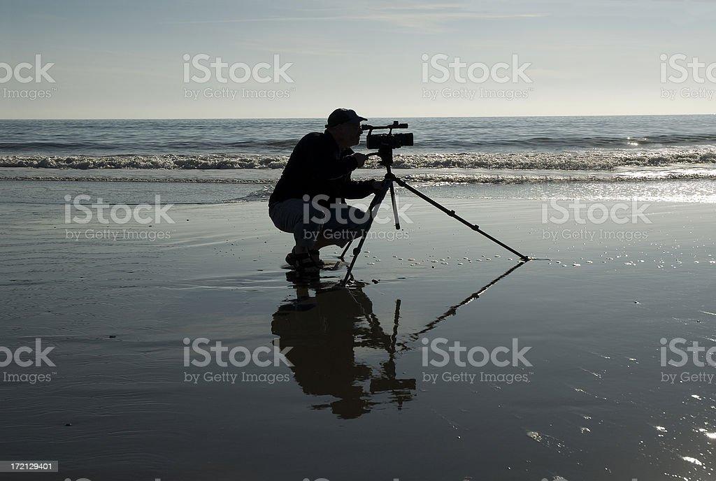 Videographer Silhouette at Shoreline stock photo