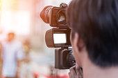 Videographer takes video camera