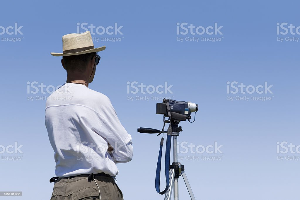 Videographer waiting for the shot royalty-free stock photo