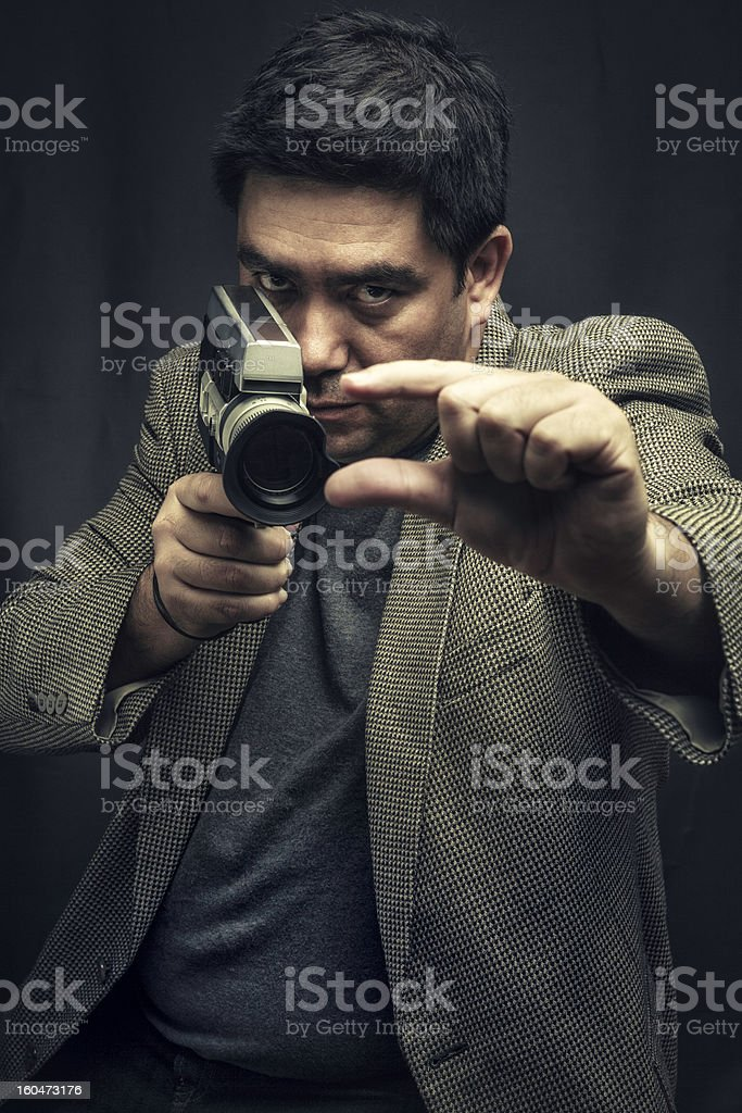 Videographer with vintage video camera royalty-free stock photo