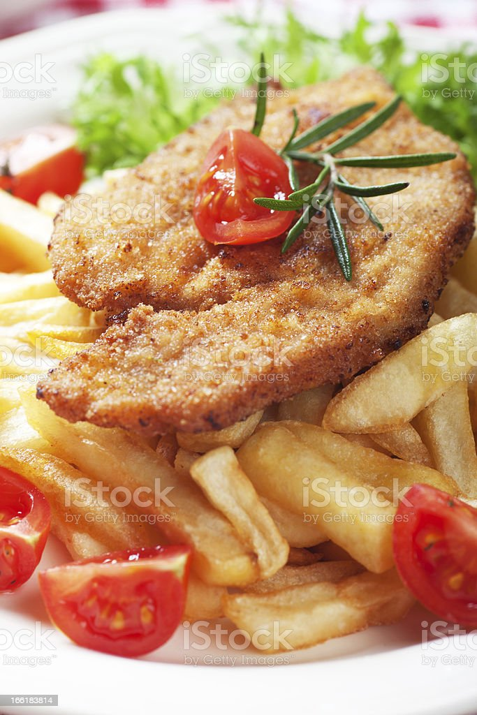 Viener schnitzel, breaded steak with french fries royalty-free stock photo
