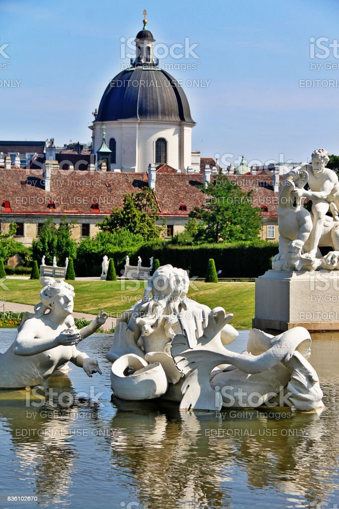 Vienna (Wien), Austria (Osterreich) - June 24, 2017 - Fountain sculptures in Belvedere Gardens with Salesianer church (Salesianerinnenkirche) stock photo